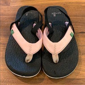 Little girls Sanuk flip flops